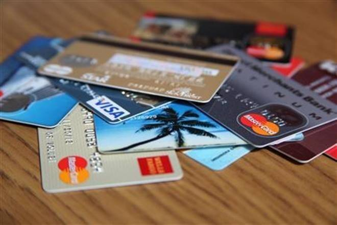Debit, credit card use climbs back to pre-COVID level; consumer spending rises amid layoffs, salary cuts
